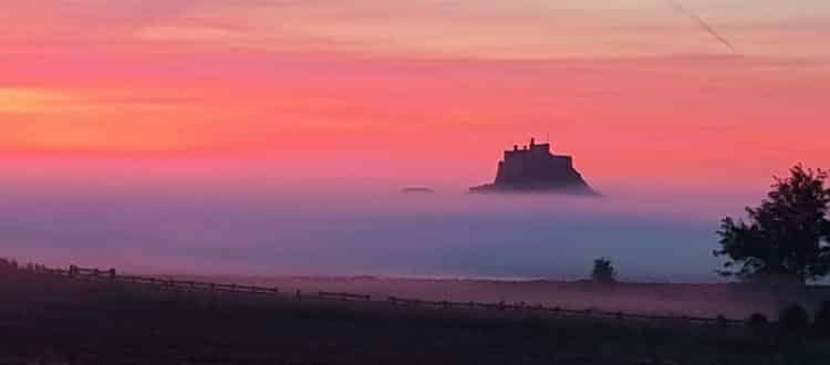 Lindisfarne Castle in the mists, for post on getting to Holy Island by public transport