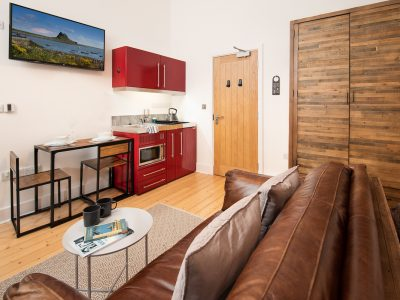 Reiver Studio - showing kitchenette, breakfast table, wardrobe and sofa