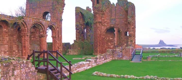 Lindisfarne Priory Ruins with Lindisfarne Castle in the background